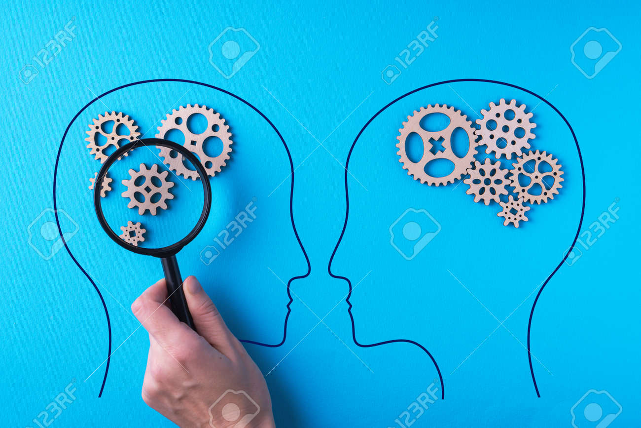 Human brain is made gear mechanism on blue background. The brain is viewed through a magnifying glass. Two different thought processes, concept of different thinking. - 166111031