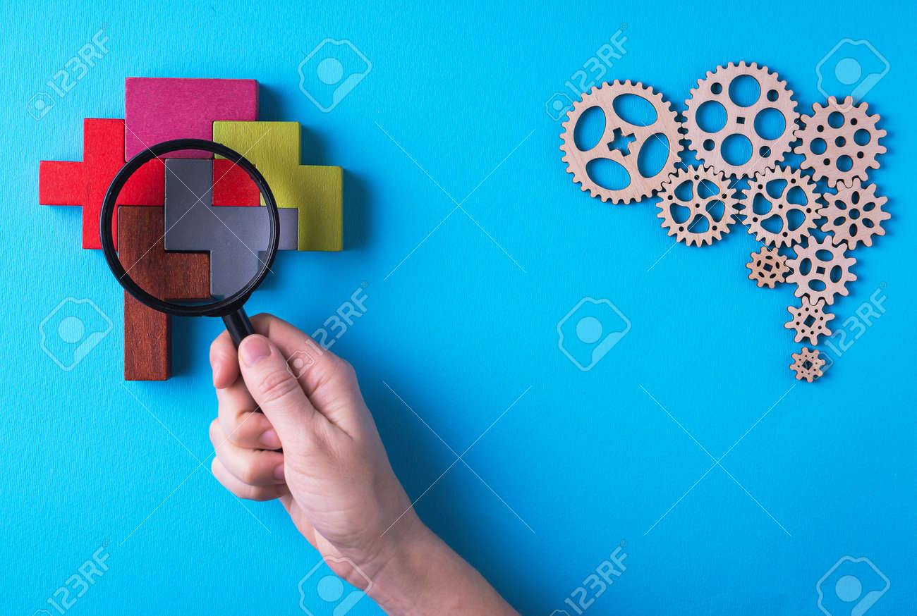 Human brain is made gear mechanism and colorful shapes on blue background. The brain is viewed through a magnifying glass. Two different thought processes, concept of different thinking. - 166460946