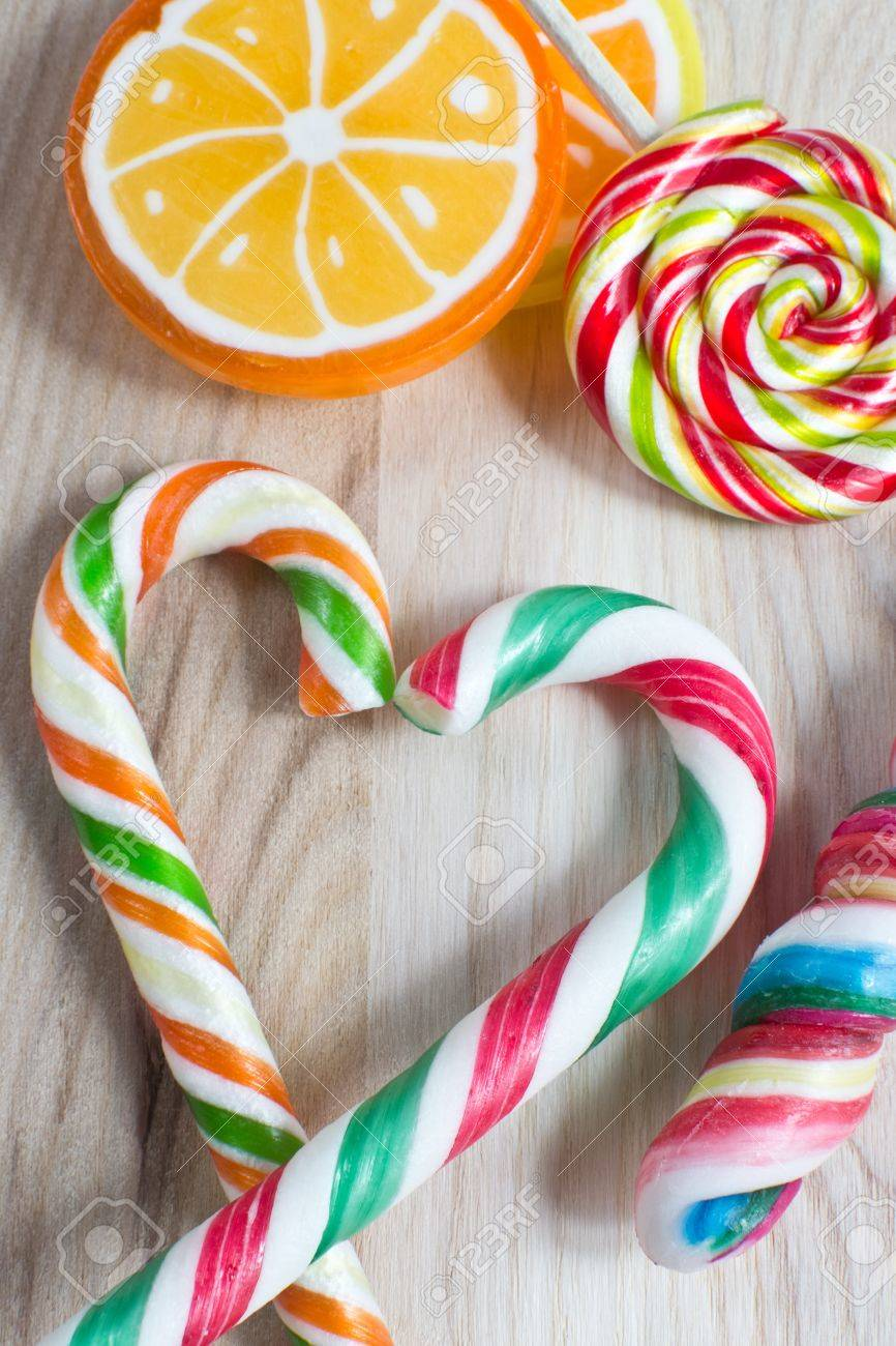 colorful lollipop on wooden background Stock Photo - 17122949