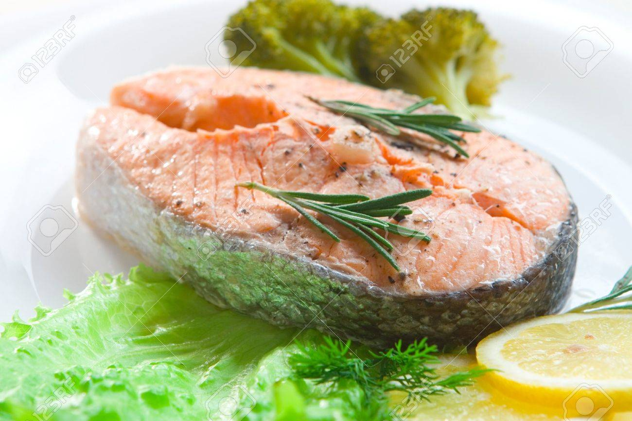 Prepared salmon steak with broccoli and lemon slices on white plate Stock Photo - 3828365