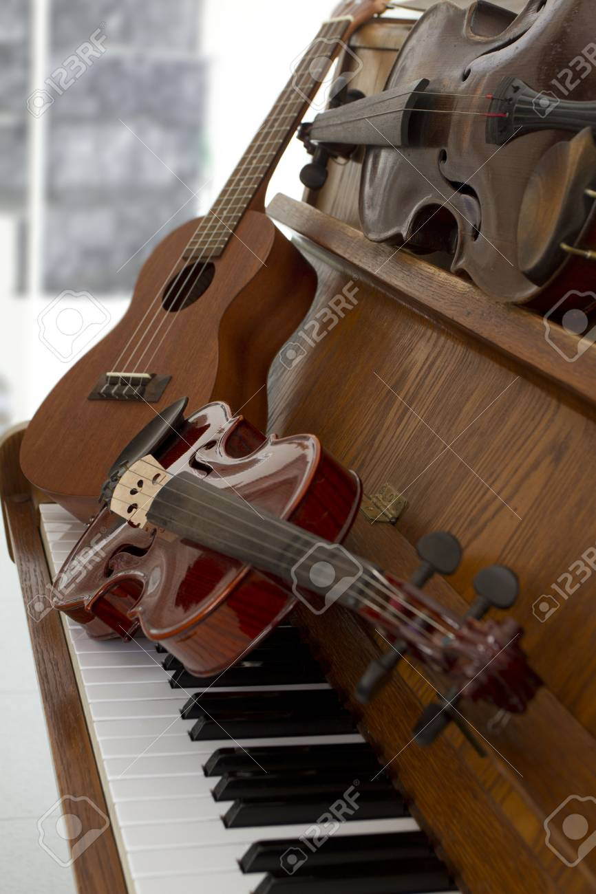 Classical violins on piano keys, guitar and cymbal  Classical