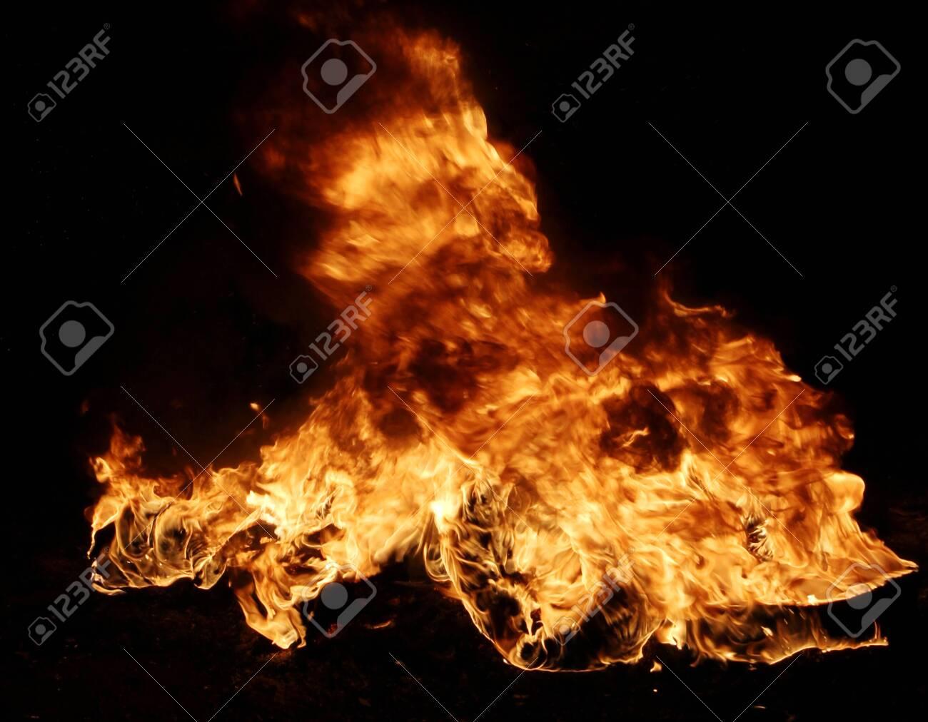 Burning tires creating big black smoke and pollution. - 136728720