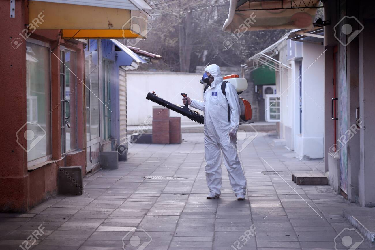 Disinfection and decontamination on a public place as a prevention against Coronavirus disease 2019, COVID-19. - 142850651