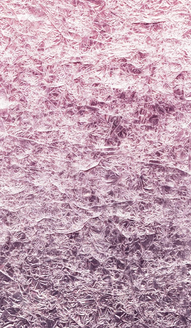 Background Of Foil Rose Gold And Purple Color Sparkle Wrinkled