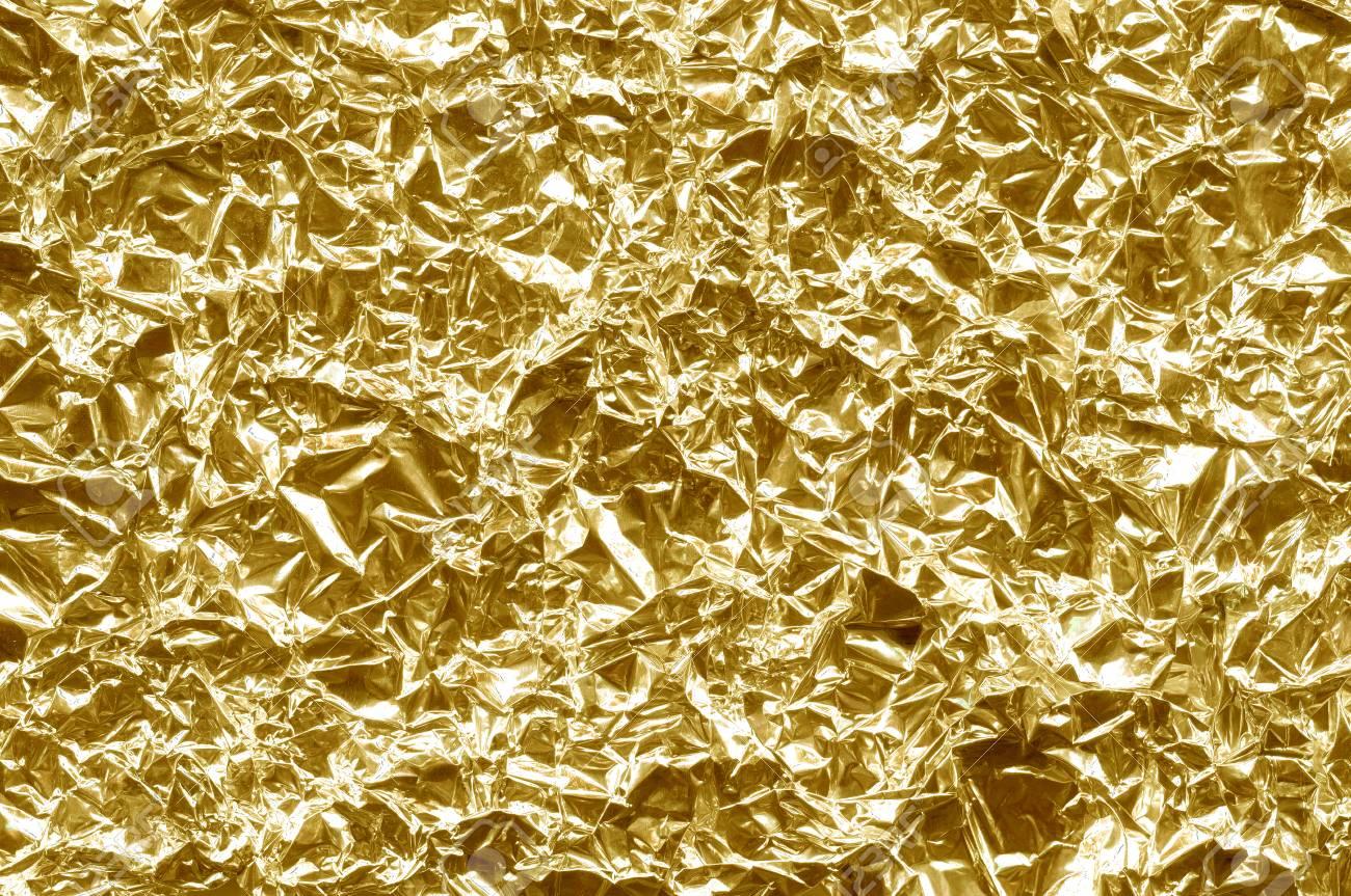 Fondo de la lámina. El color dorado brillante. Chispa de textura arrugada. Amarillo metalizado.