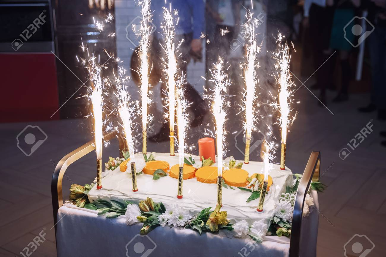 Marvelous Celebratory Cake With Fireworks Birthday In Restaurant Stock Funny Birthday Cards Online Alyptdamsfinfo