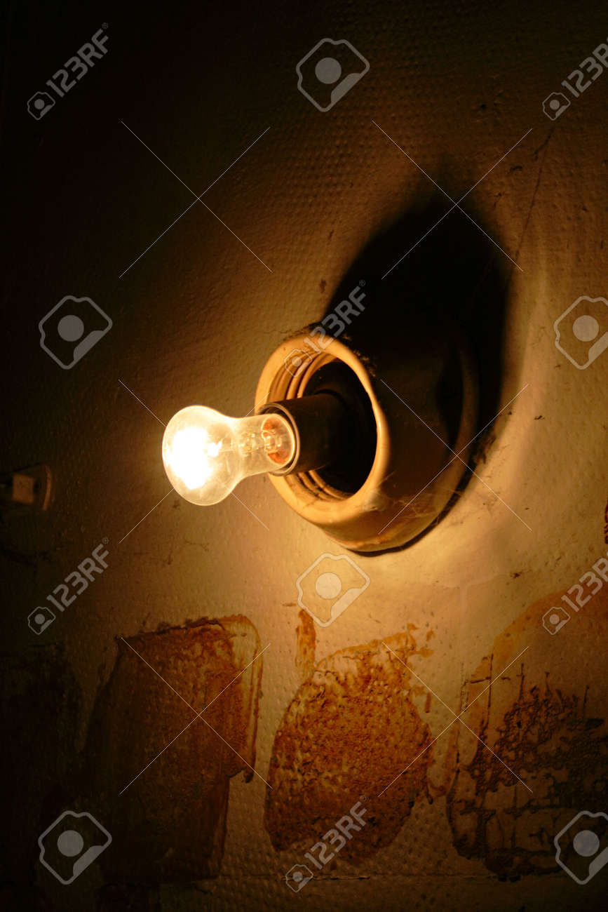 Single bulb on stone building in cave Stock Photo - 838023