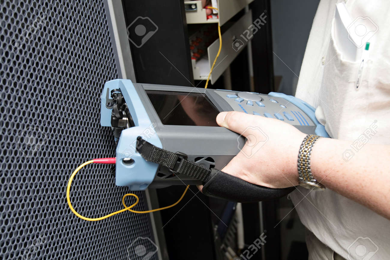 Engineer with reflectometer tests optical transmission line Stock Photo - 1305464