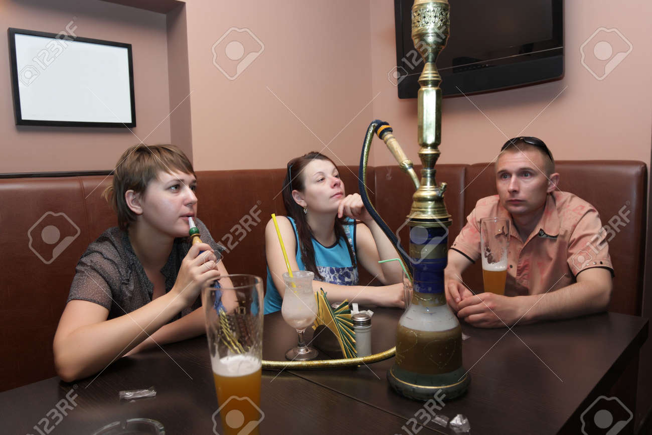 The friends resting in a Arabic cafe Stock Photo - 5031772
