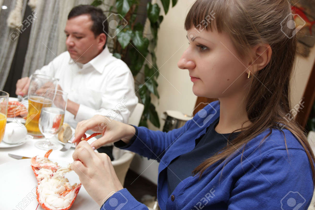 Couple eating lobster in a seafood restaurant Stock Photo - 5442813