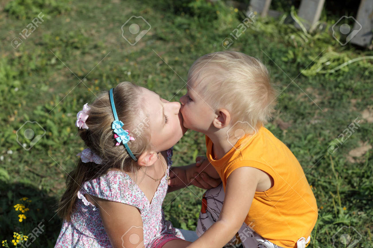 These are kissing siblings in the garden Stock Photo - 10255304