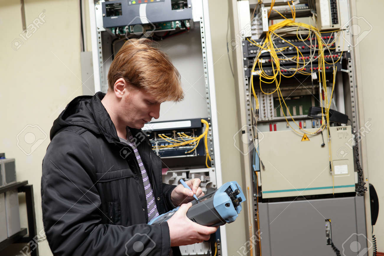 Telecom Engineer Adjusting Reflectometer On The Telecom Site Stock ...