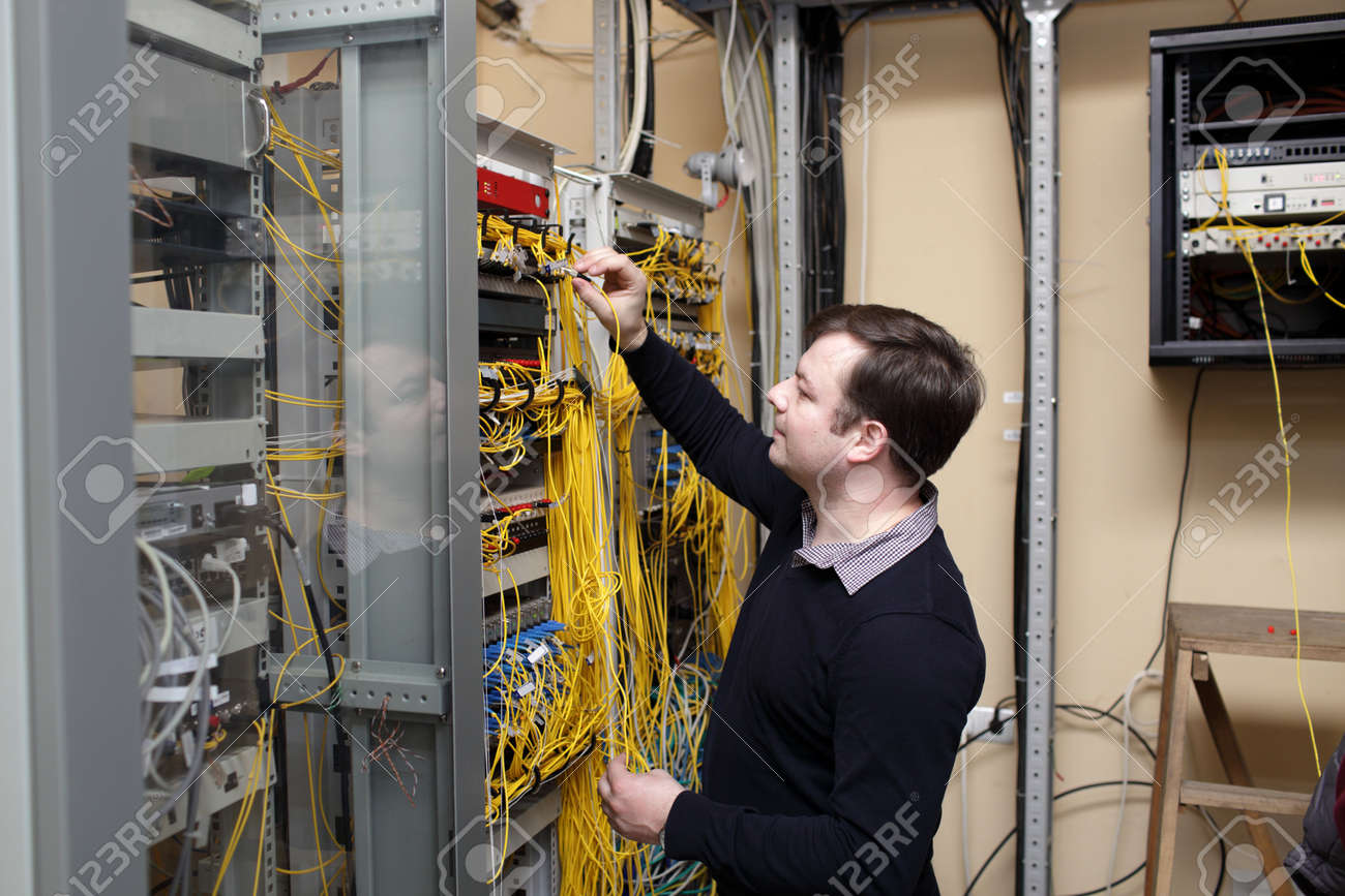 The Network Technician Connecting Fiber Optic At Server Room Stock ...