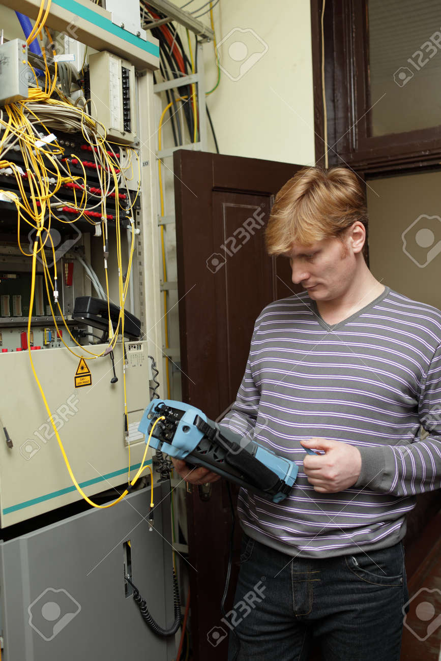 The Technician Measuring Fiber Optic At A Server Room Stock Photo ...