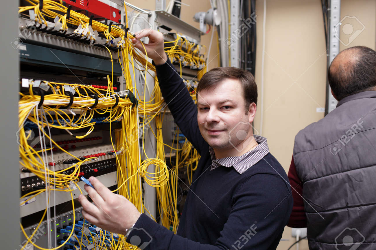 The Happy Technician Posing At Server Room Stock Photo, Picture ...
