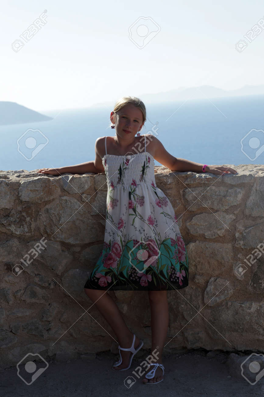 Child is posing in castle Monolithos, Rhodes, Greece Stock Photo - 15971743
