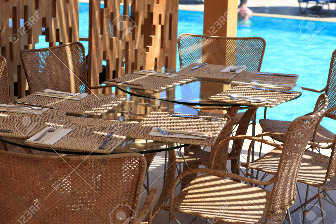 The empty cafe near pool, Rhodes, Greece Stock Photo - 16297881