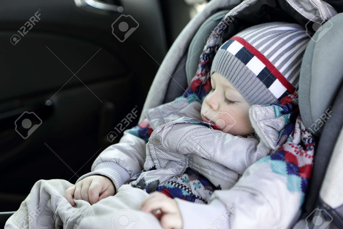 Toddler Sleeping In Baby Car Seat At Day Stock Photo Picture And