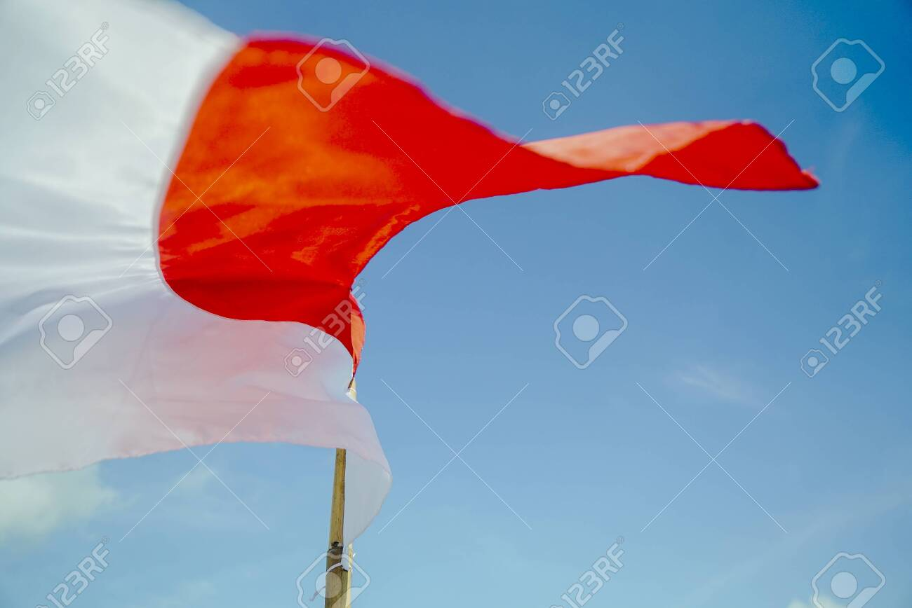 indonesian flag with blue sky background merah putih on indonesian stock photo picture and royalty free image image 128389682 indonesian flag with blue sky background merah putih on indonesian
