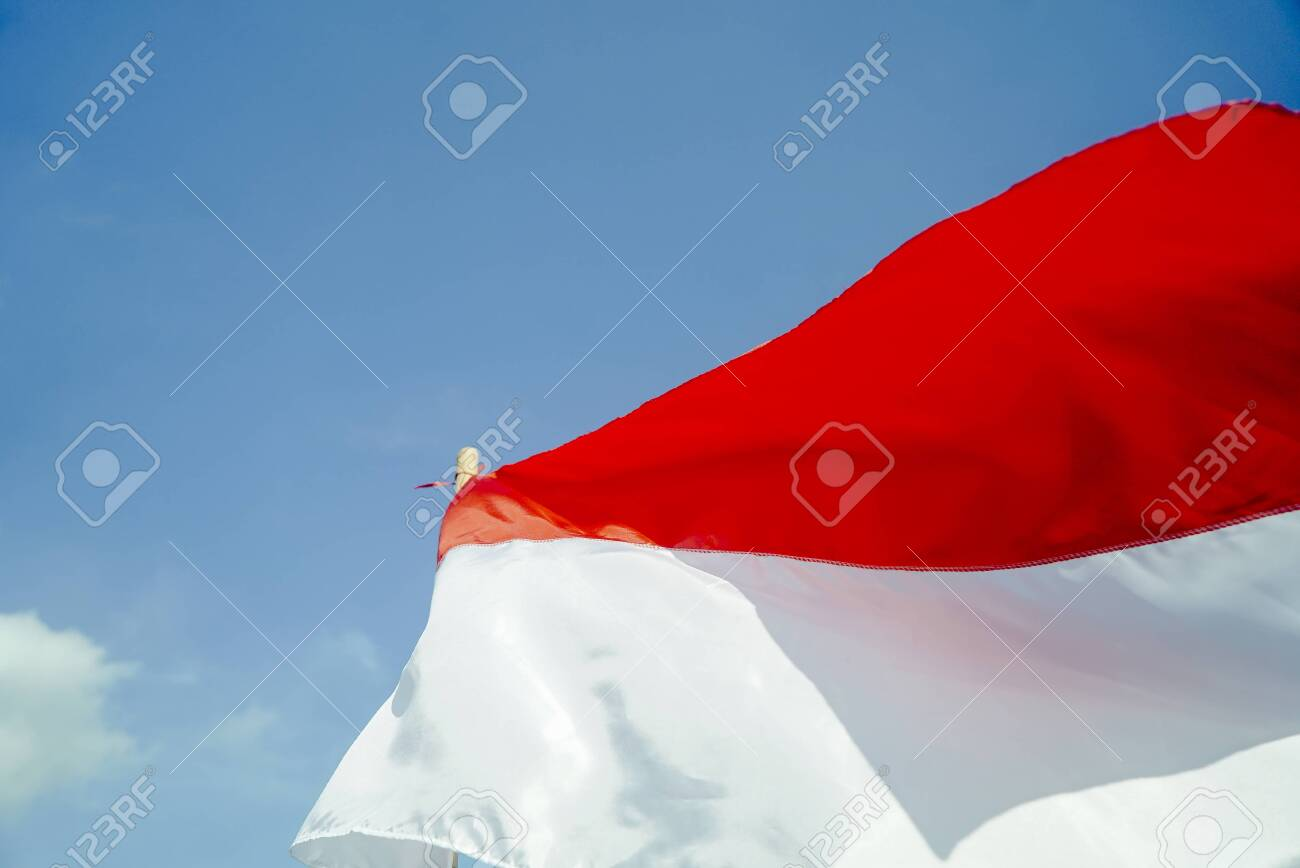indonesian flag with blue sky background merah putih on indonesian stock photo picture and royalty free image image 128389695 indonesian flag with blue sky background merah putih on indonesian