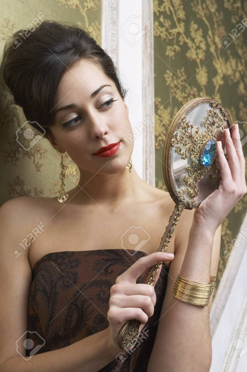Portrait Of Woman Holding Mirror Stock Photo Picture And Royalty