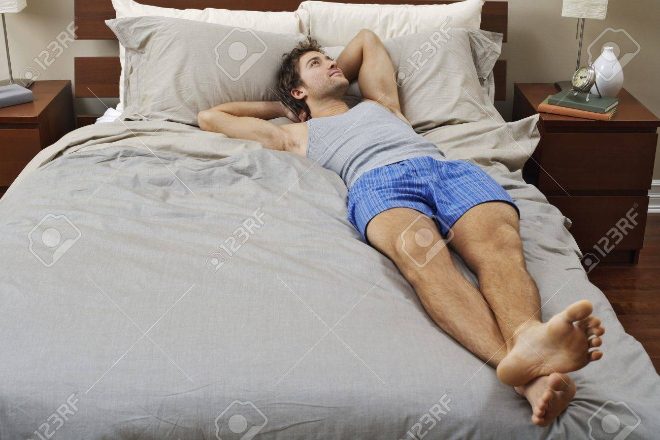 Man Lying On Bed Stock Photo Picture And Royalty Free Image