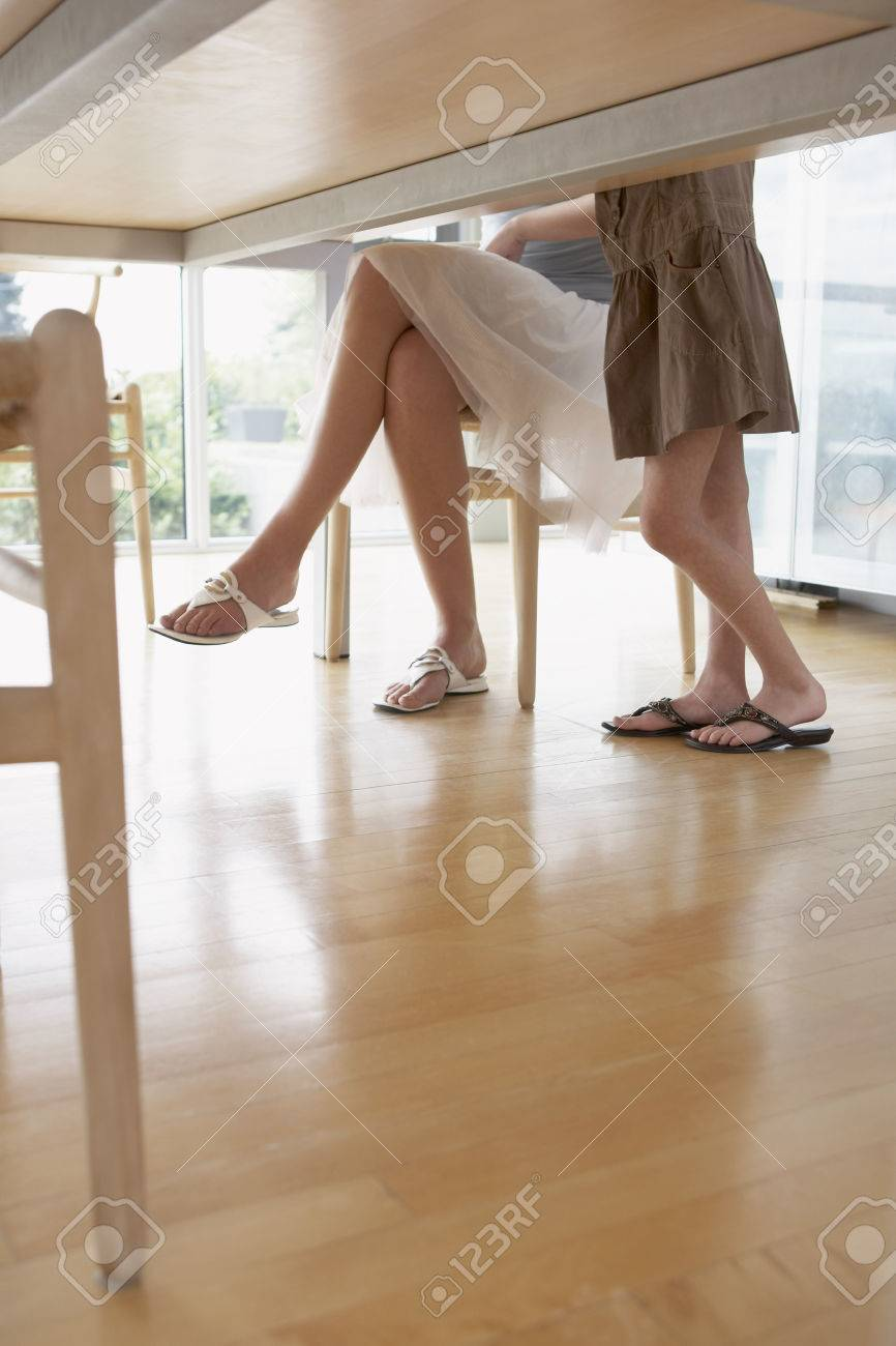 View Of Peoples Legs Under Table Stock Photo Picture And Royalty