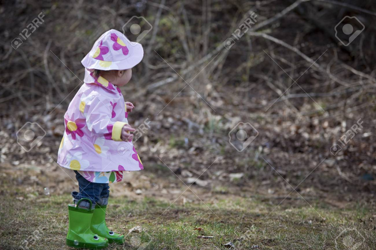 Little Girl in the Park Wearing Raincoat, Hat, and Boots, Bethesda,