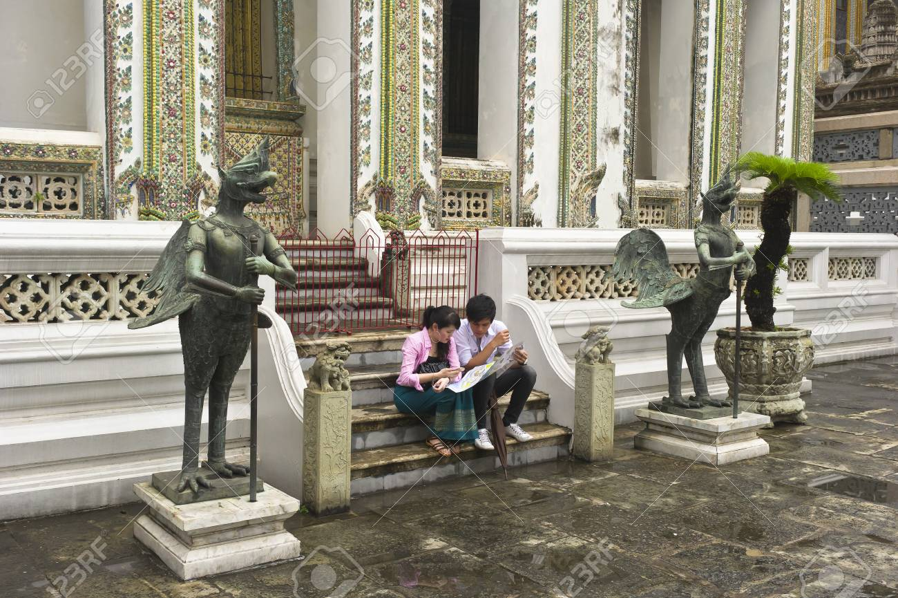 Couple Sitting On Temple Steps Reading A Map Wat Phra Kaew Stock