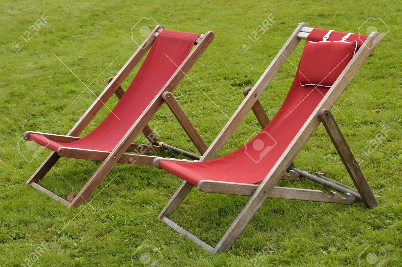 Canvas Lawn Chairs On Grass, Alps, France Stock Photo   86654324