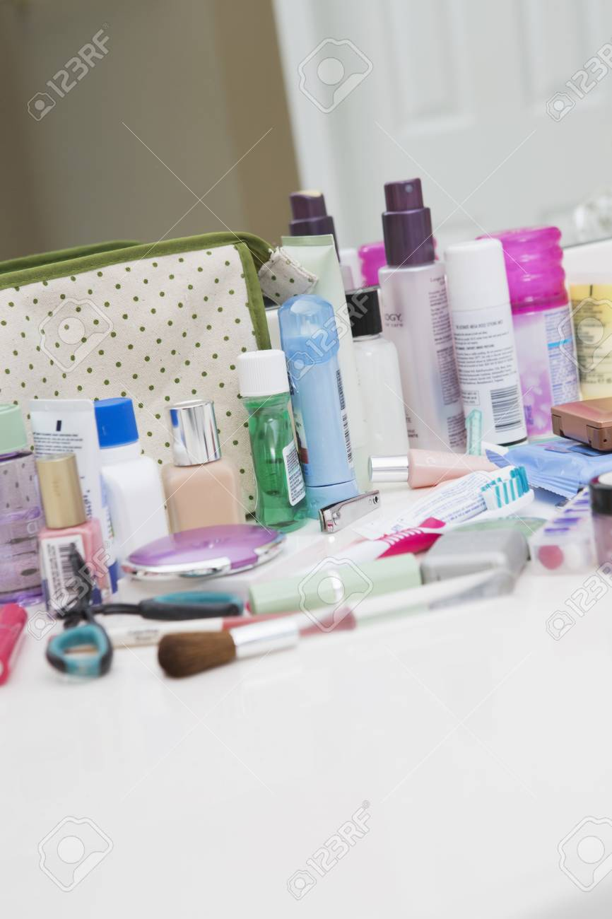 Stock Photo   Womenu0027s Toiletries And Cosmetic Travel Bag On Bathroom  Counter, With Toothbrush, Lotion, Makeup And Other Beauty Products, USA