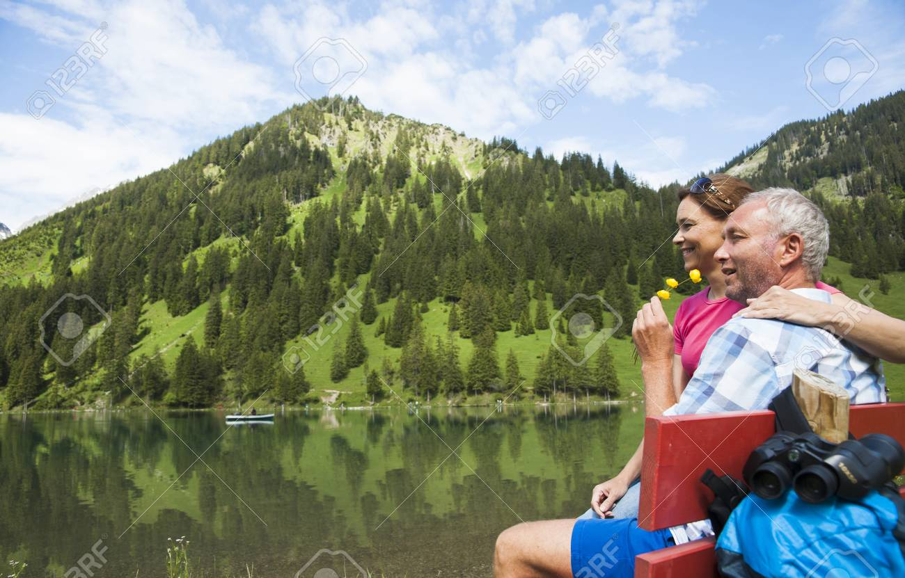 Mature Couple Relaxing At Lake Vilsalpsee Tannheim Valley