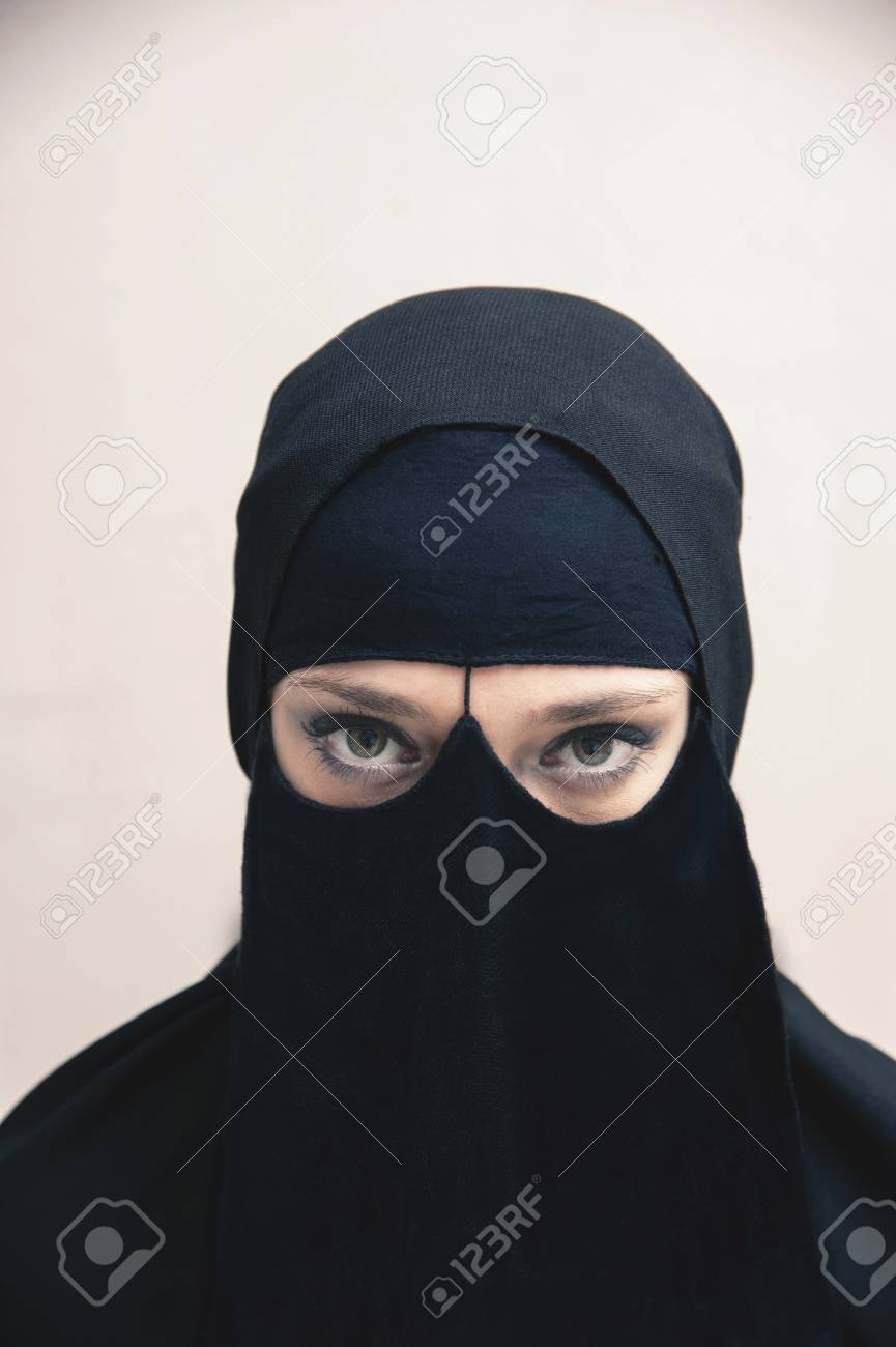 Portrait Of Young Woman In Black Muslim Hijab And Dress Eyes Looking At