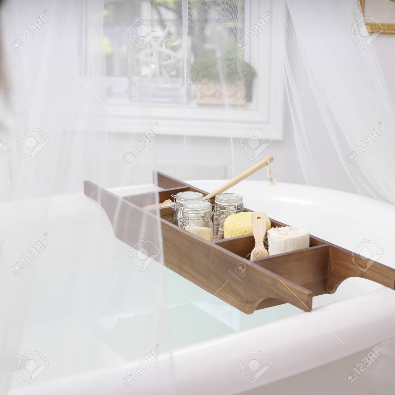 Bath Caddy On Bathtub Filled With Bath Items Stock Photo, Picture ...