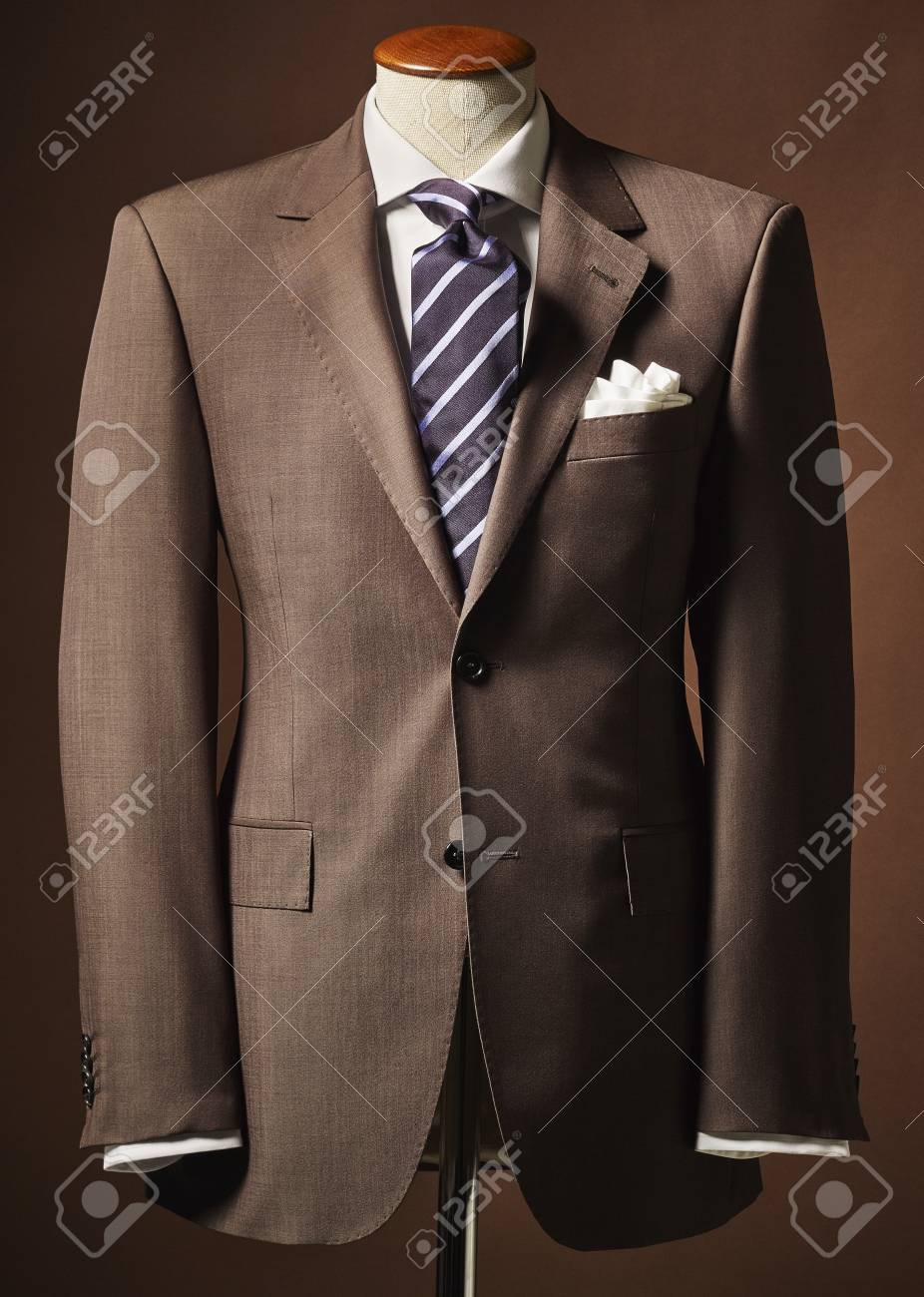 43226c669152e Brown suit jacket on bust with handkerchief and tie on brown background  Stock Photo - 87078411