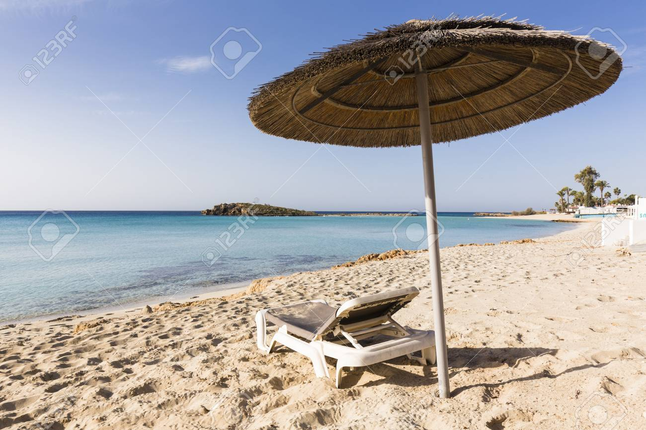 Beach Umbrella And Lounge Chair On Nissi Beach At The Nissi Beach Resort In  Agia Napa