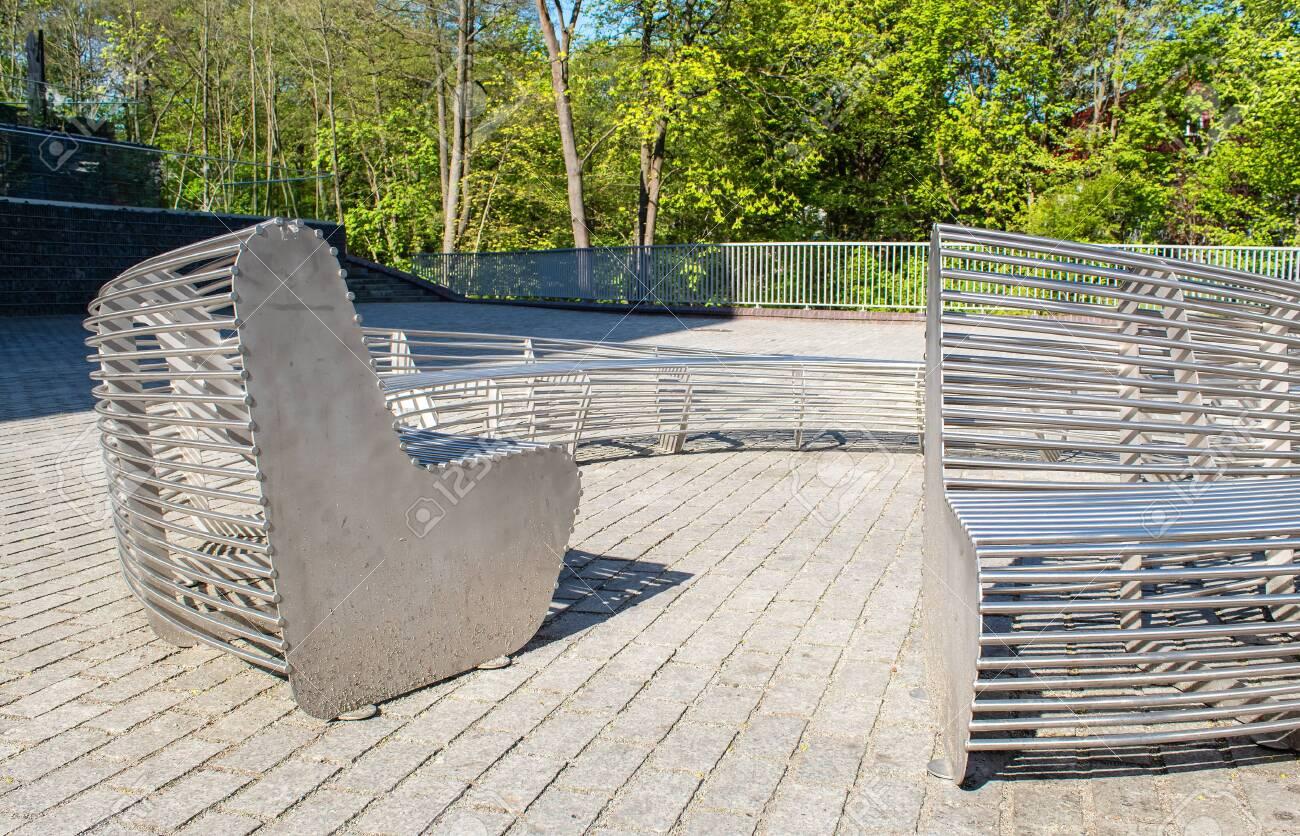 Swell Modern Metal Round Garden Bench In The City Park On Sunny Summer Machost Co Dining Chair Design Ideas Machostcouk
