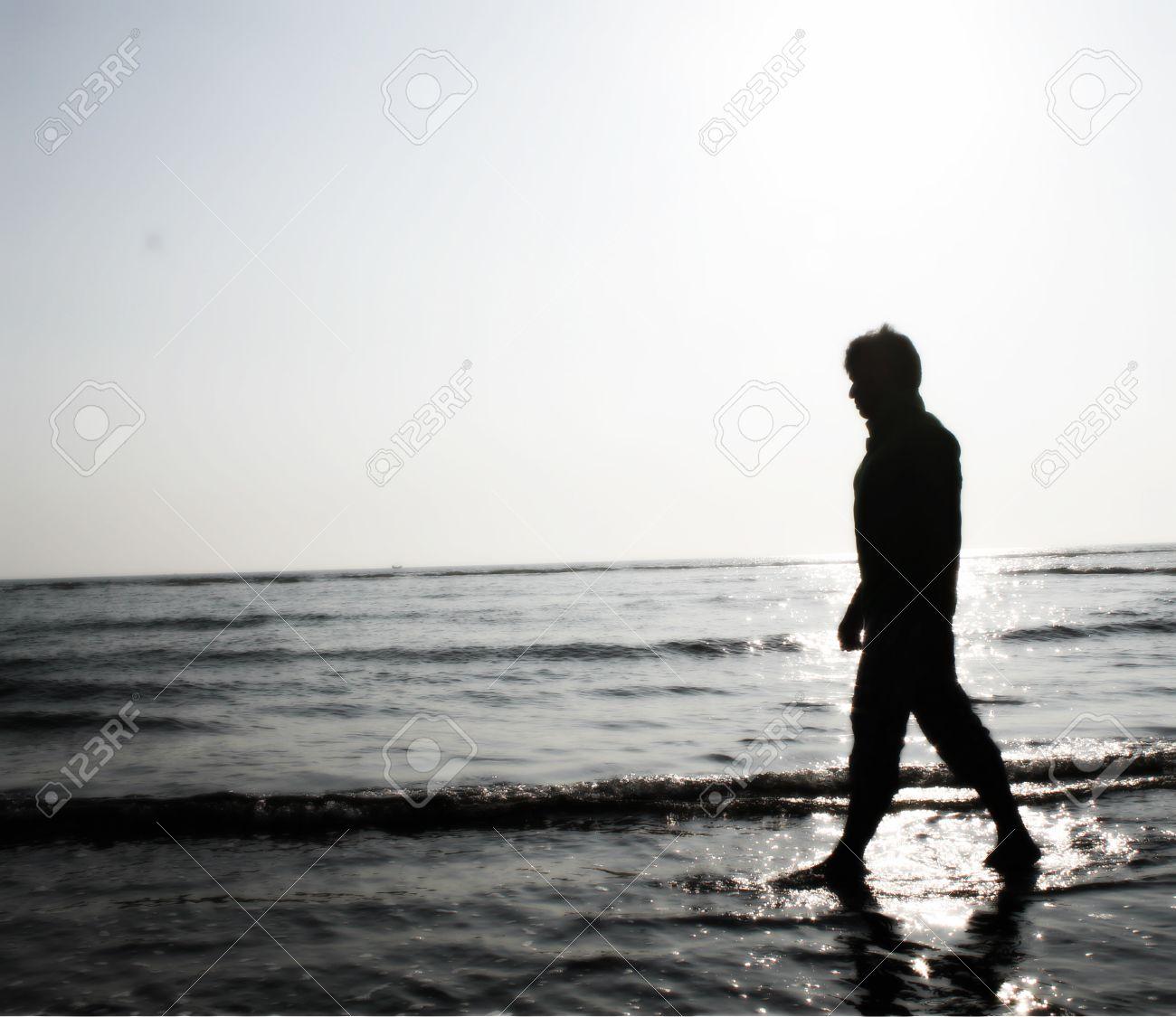 Sad boy walking near beach stock photo 37771257