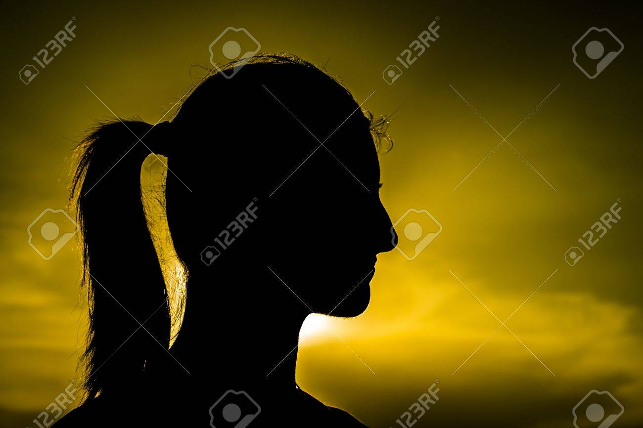 Portrait Of A Girl Silhouette With Sunset As Background Stock Photo - 18664851