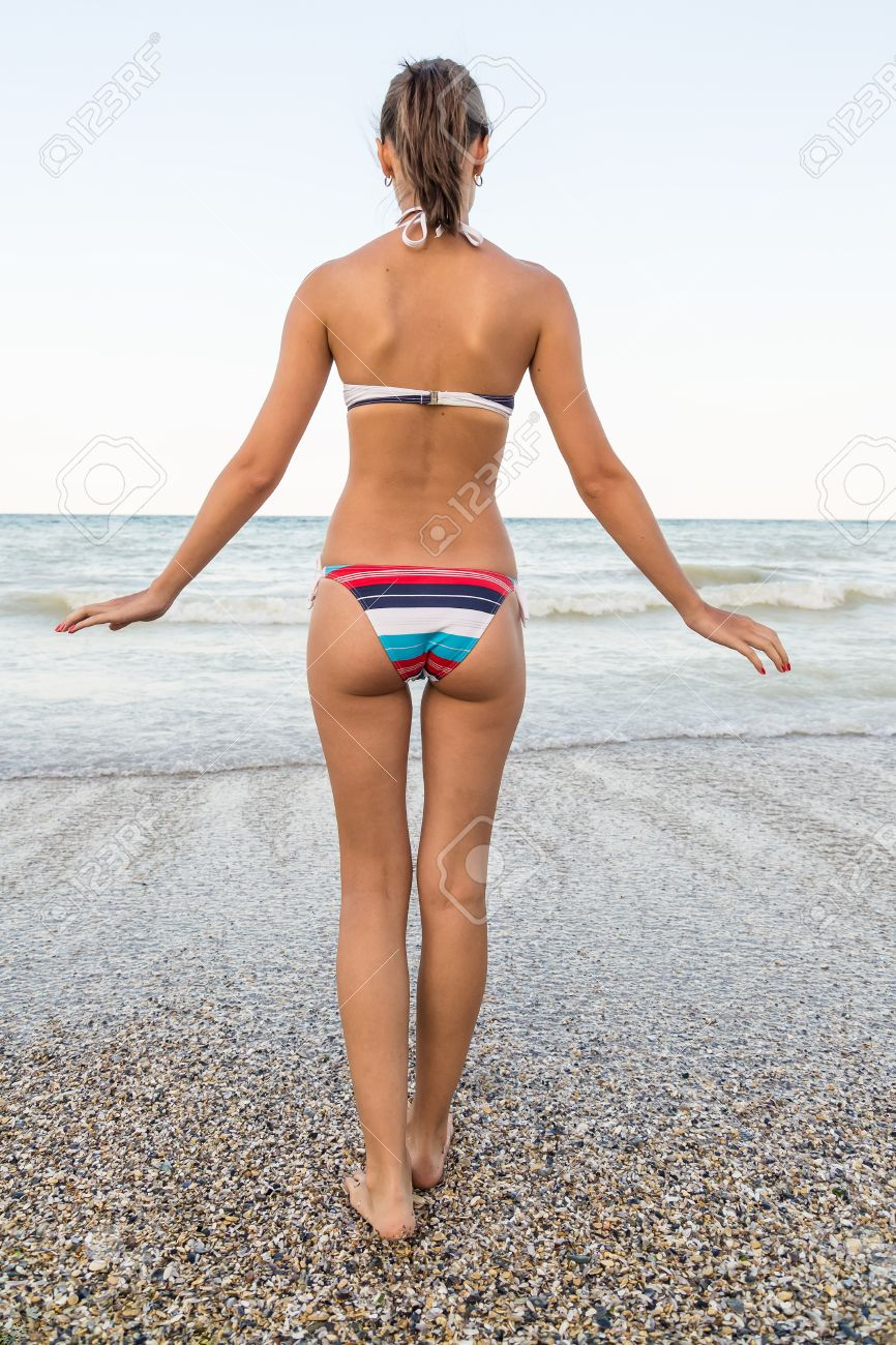 Beautiful Sexy Girl On The Beach Walking Toward The Water Stock Photo 18664883
