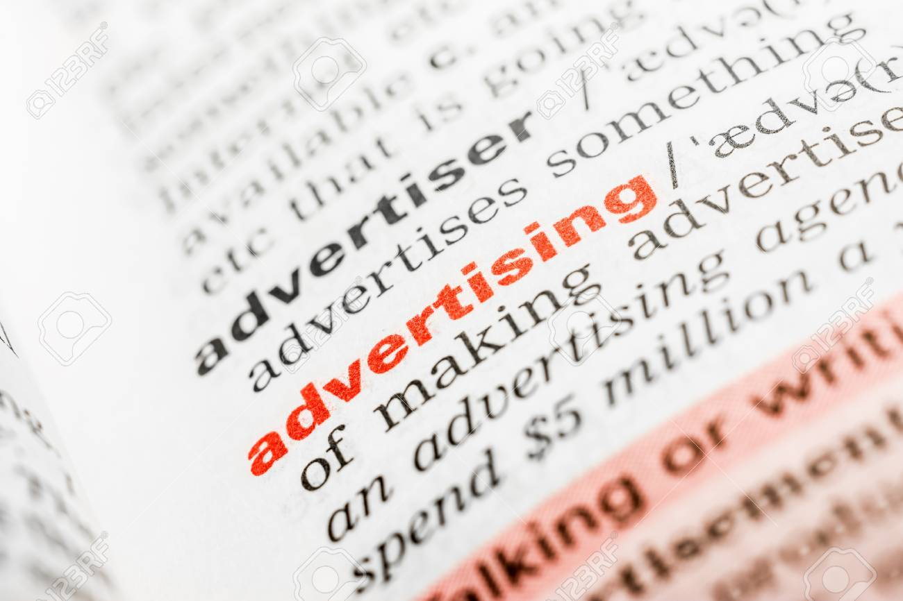 Advertising Word Definition In Dictionary Close Up Stock Photo