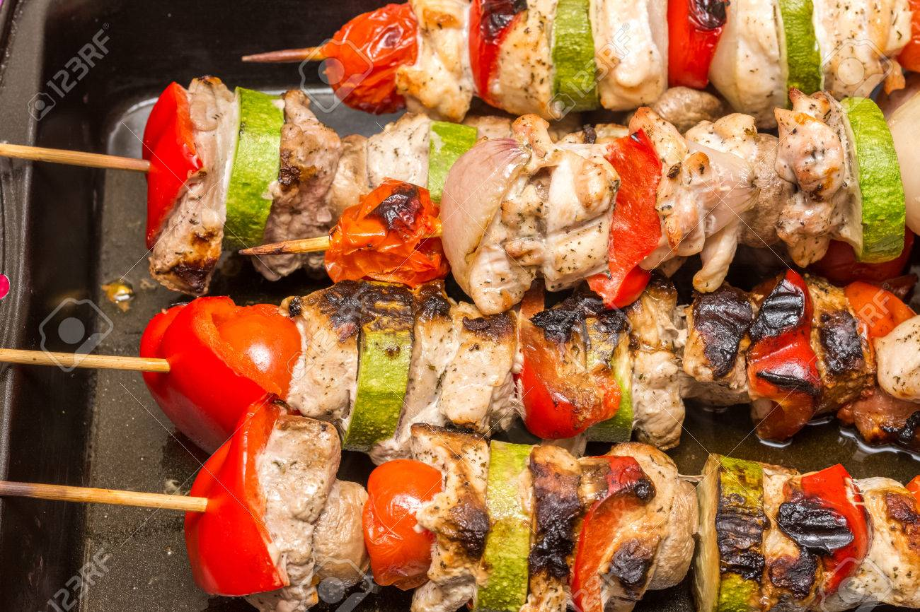 Barbecue Shishkabob With Chicken Meat Red Peppers Mushrooms Tomatoes And Zucchini Stock Photo
