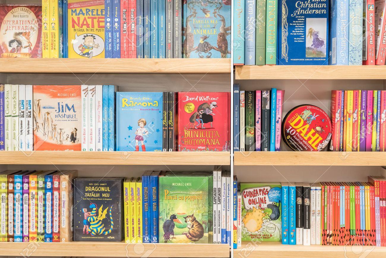 bucharest romania  february   bookshelf in library  - bucharest romania  february   bookshelf in library with childrenbooks for