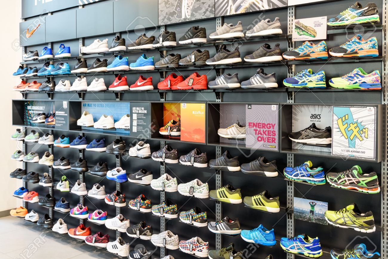 VIENNA, AUSTRIA - AUGUST 08, 2015: Nike Running Shoes For Sale In Nike Shoe Store Display. - 51281787