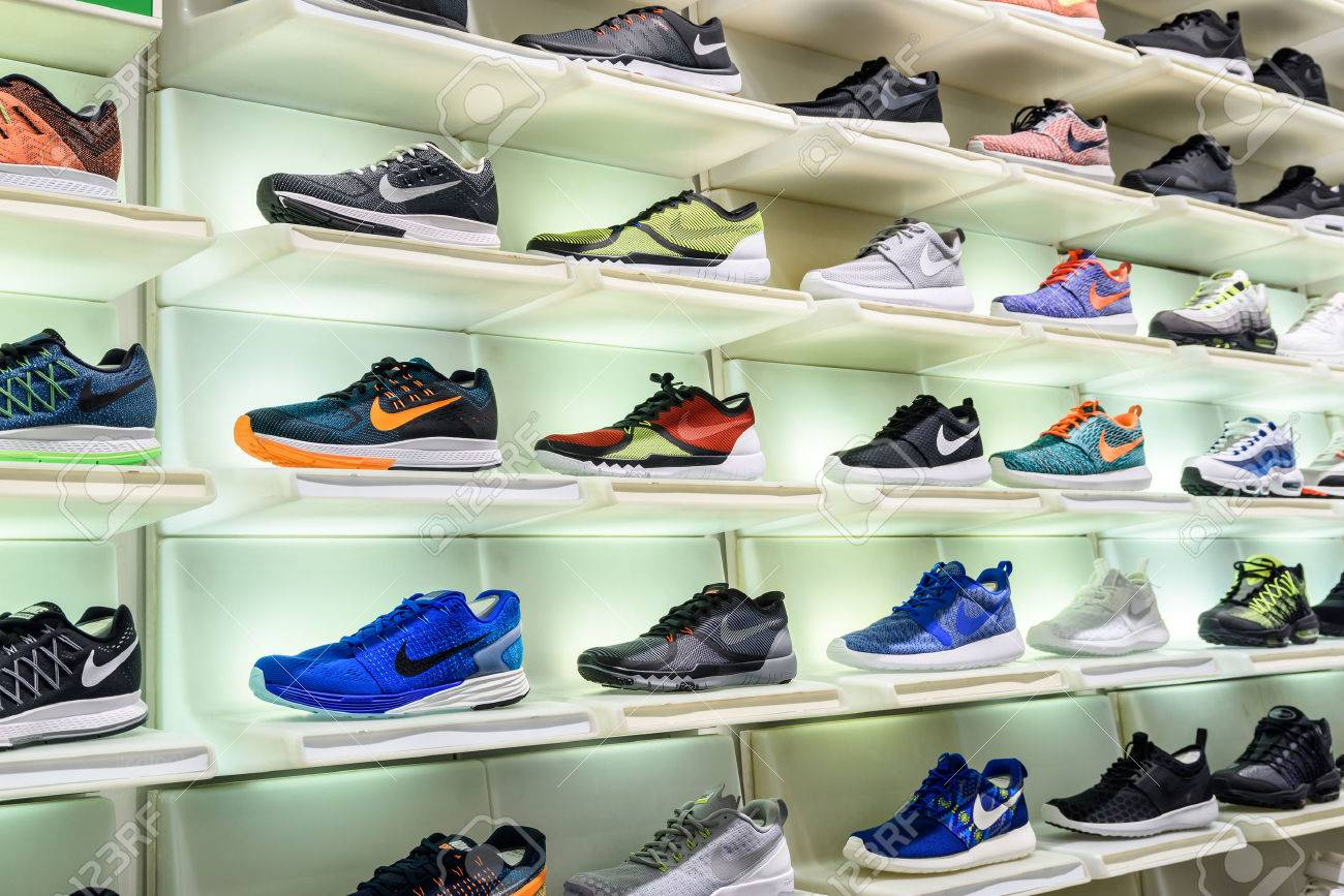 VIENNA, AUSTRIA - AUGUST 08, 2015: Nike Running Shoes For Sale In Nike Shoe Store Display. - 52859391