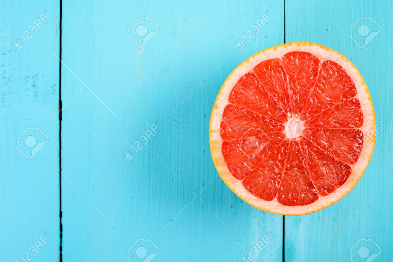 Image result for grapefruit and oranges on wooden table