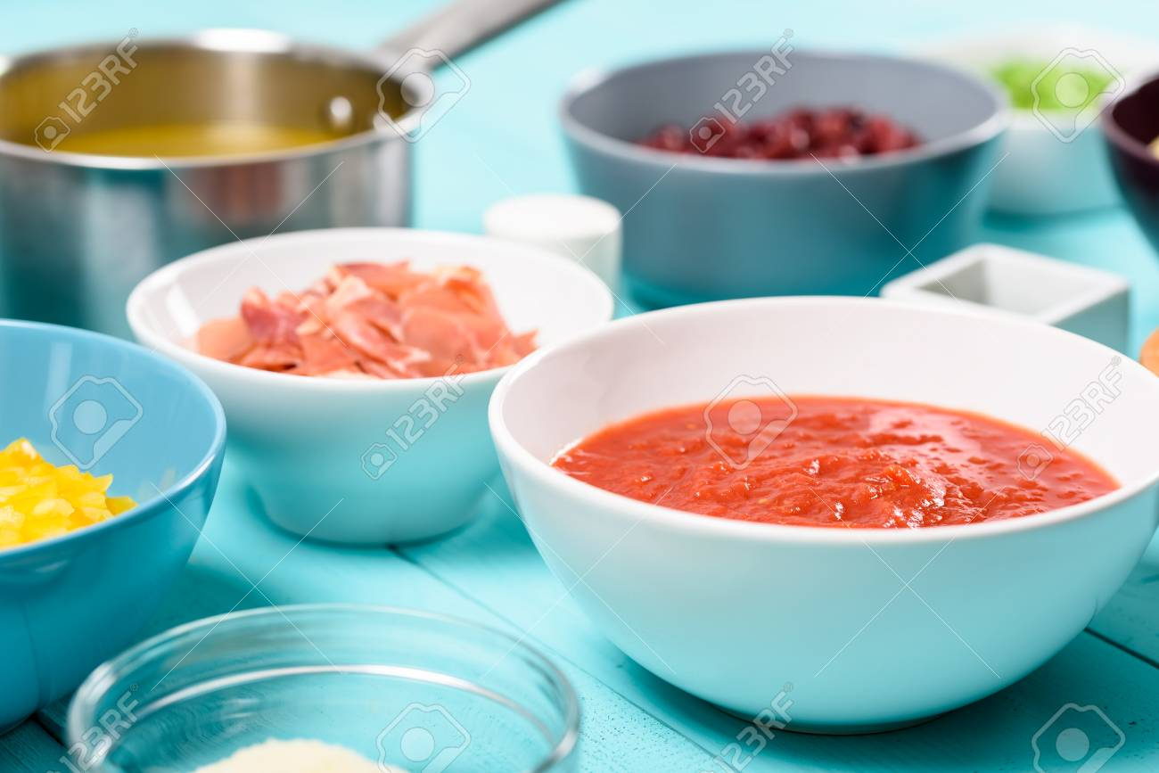 Tomato Sauce And Food Ingredients On Turquoise Kitchen Table Stock ...