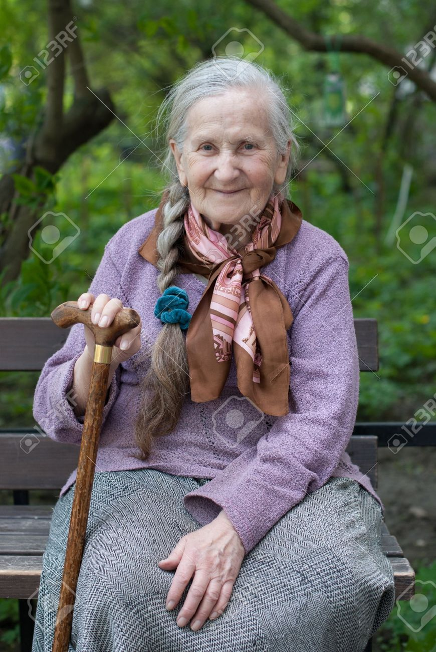 old grandmother with a long braid in the summer in the garden Stock Photo - 20110747