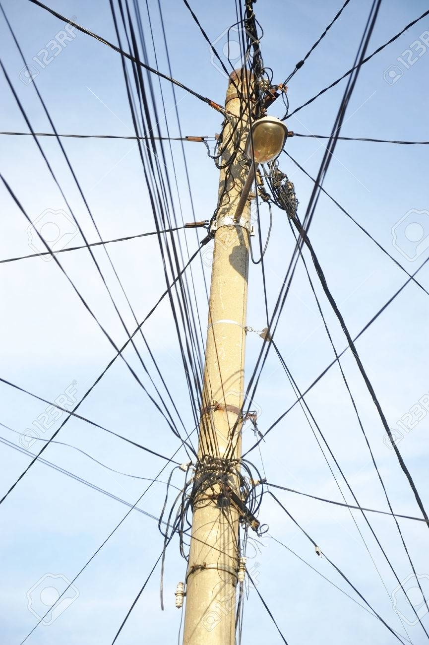 Public Electricity Pole With Lots Of Tangled Wires Stock Photo ...
