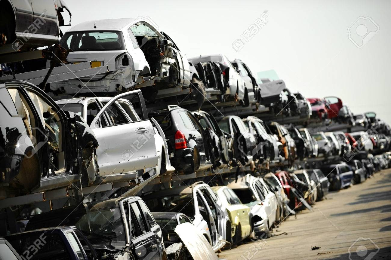Wrecked Vehicles Are Seen In A Car Junkyard Stock Photo, Picture And ...